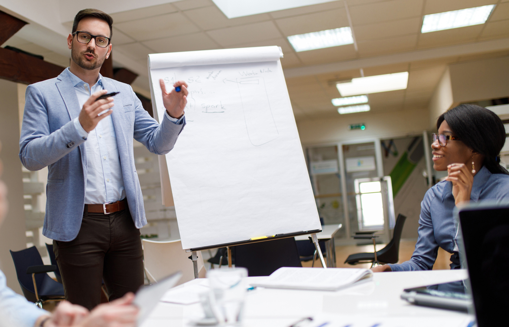 Businessman presenting new project to partners in the office